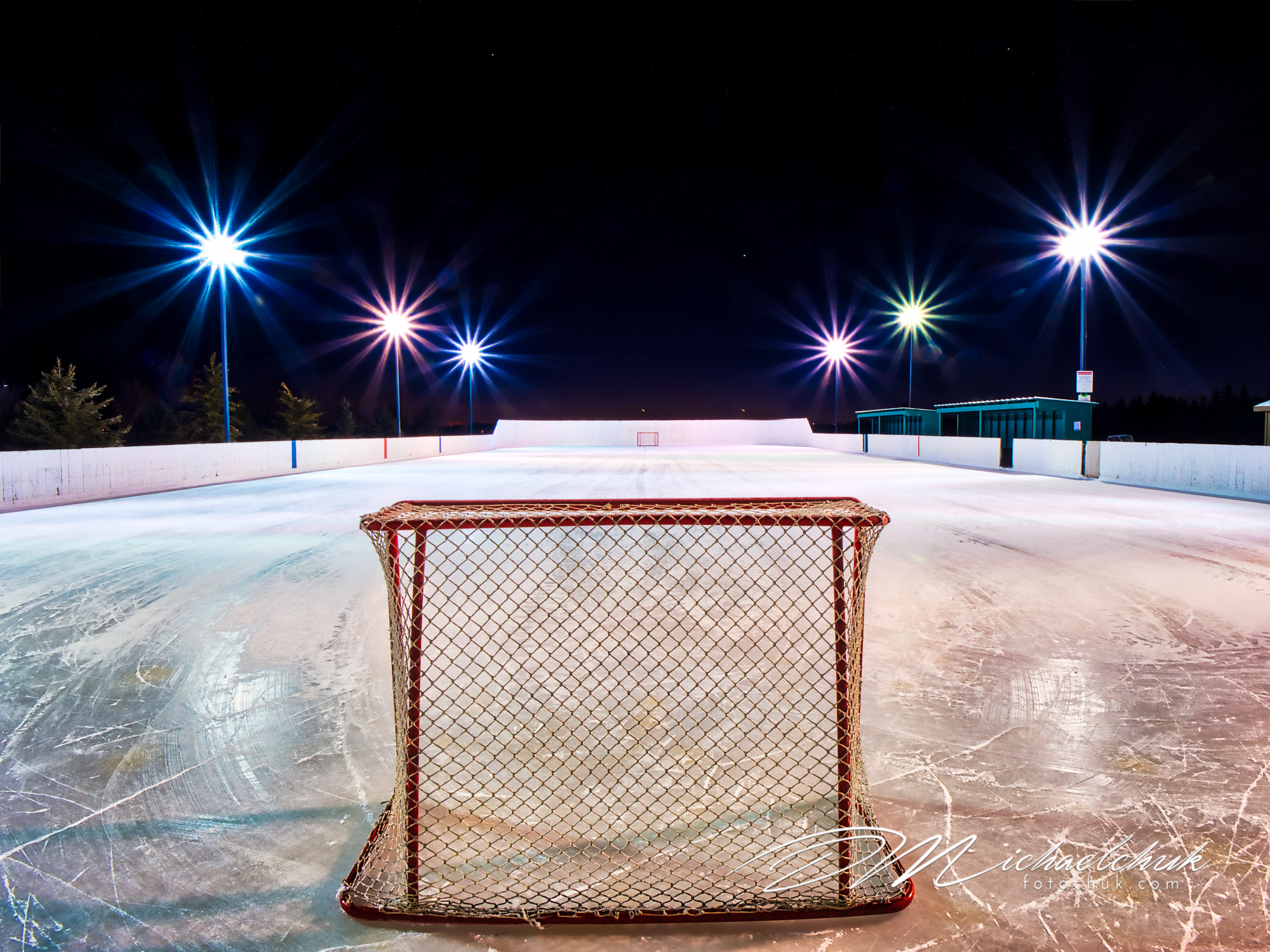 Empty outdoor rink at night